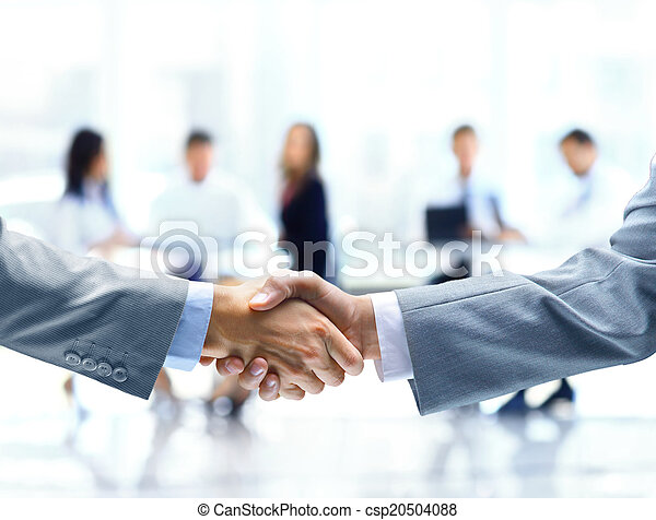 Close up of businessmen shaking hands - csp20504088