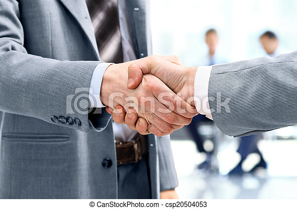Close up of businessmen shaking hands - csp20504053