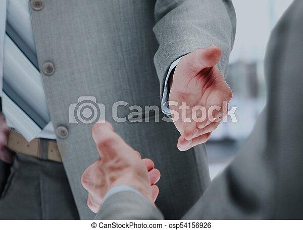 Close up of businessmen shaking hands. - csp54156926