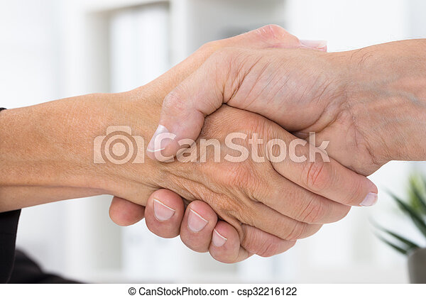 Close-up Of Businesspeople Shaking Hands - csp32216122