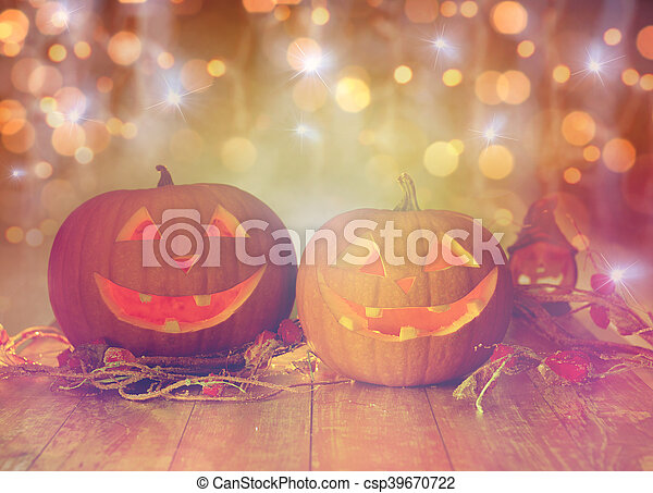 close up of carved halloween pumpkins on table - csp39670722