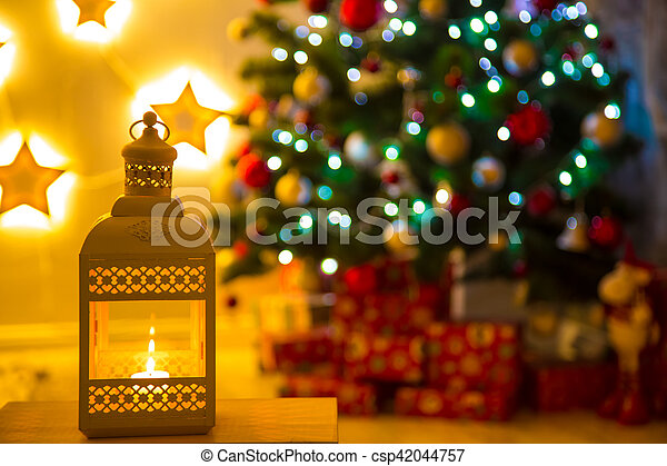 Christmas Lantern.Close Up Of Christmas Lantern With Burning Candles On Blurred Background Living Room With Christmas Tree