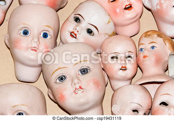 Close up of creepy doll heads - csp19431119