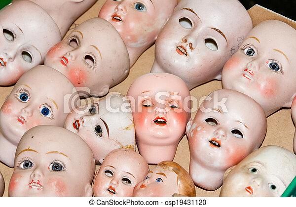 Close up of creepy doll heads - csp19431120