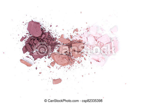 Close up of eye shadow scattered on a white isolated background - csp82335398