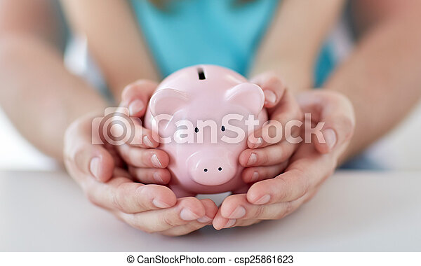 close up of family hands with piggy bank - csp25861623