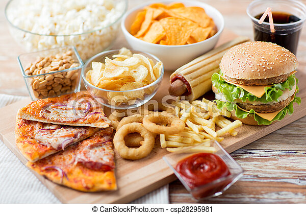 close up of fast food snacks and drink on table - csp28295981