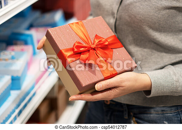 Close-up of female hands holding gift box. - csp54012787