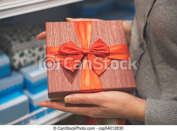 Close-up of female hands holding gift box. - csp54012830