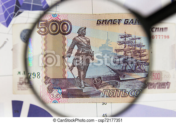 Close-up of five hundred rubles through a magnifying glass. Business background. Money research concept. - csp72177351