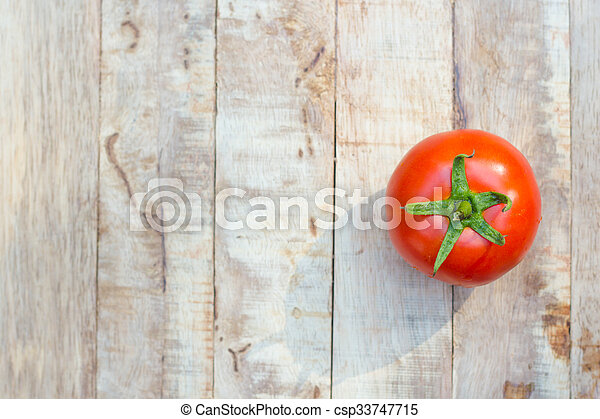 Close-up of fresh, ripe tomatoes on wood background. - csp33747715