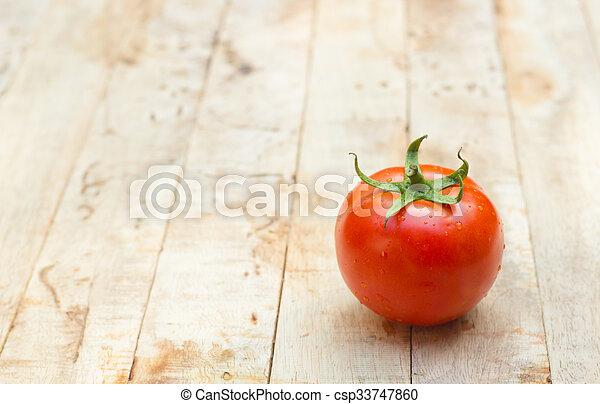 Close-up of fresh, ripe tomatoes on wood background. - csp33747860