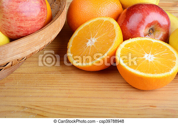Close up of fruits on wooden table. - csp39788948