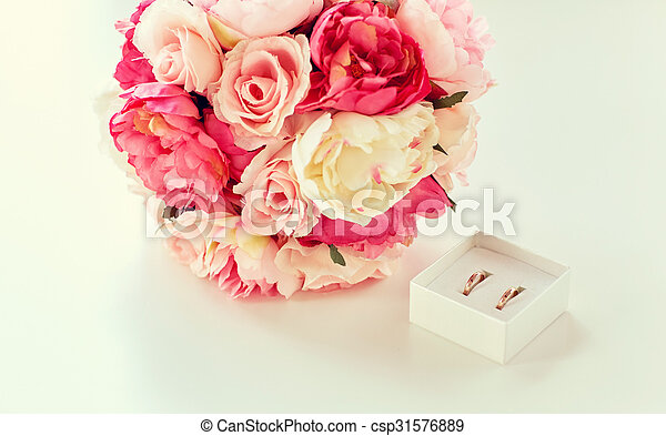 close up of gay wedding rings and flower bunch - csp31576889