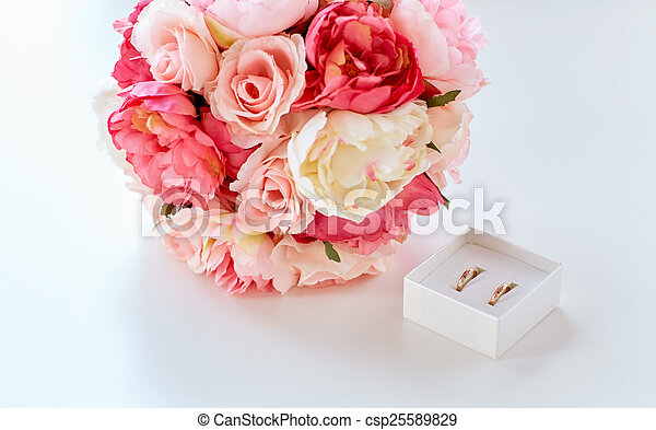 close up of gay wedding rings and flower bunch - csp25589829