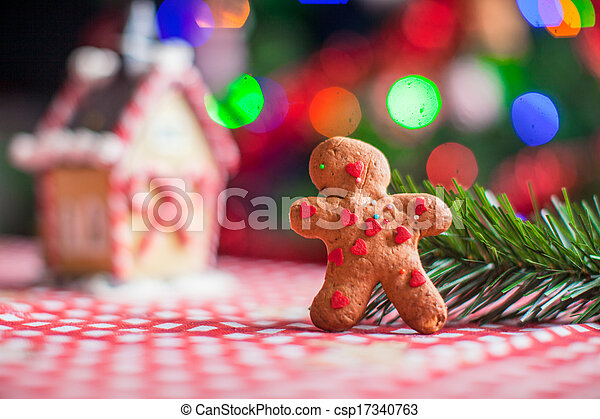 Close Up Of Gingerbread Man Background Candy Ginger House And Christmas Tree Lights