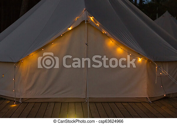 Close-up of gl&ing bell tent at night - csp63624966 & Close-up of glamping bell tent at night. front view.