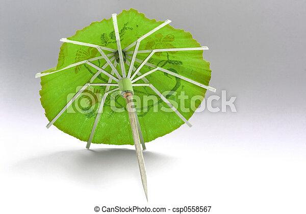 close-up of green cocktail umbrella - csp0558567