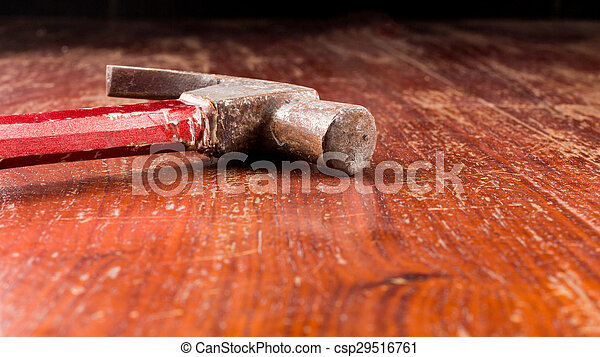 Close up of hammer on wooden table with copy space - csp29516761