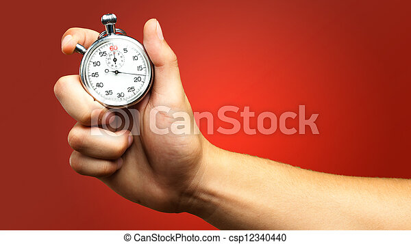 Close Up Of Hand Holding Stopwatch - csp12340440