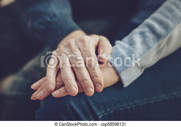 Close up of hands being held together - csp58598131