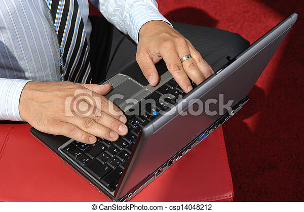 Close-Up Of Hands Working On Laptop - csp14048212