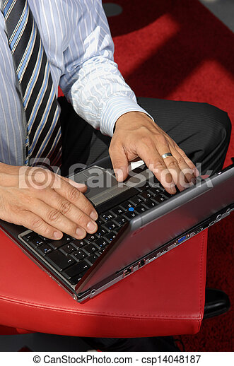 Close-Up Of Hands Working On Laptop - csp14048187