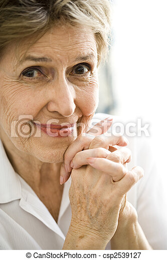 Close up of happy elderly woman - csp2539127