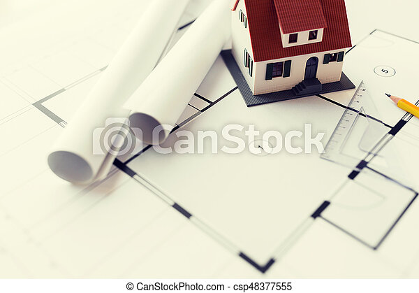 Close up of house model on architectural blueprint stock images close up of house model on architectural blueprint csp48377555 malvernweather Choice Image