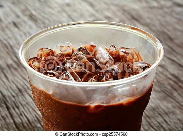 Close up of ice chocolate on table wood - csp25574560