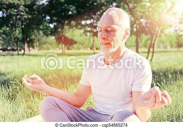 Close up of man doing yoga - csp54865274