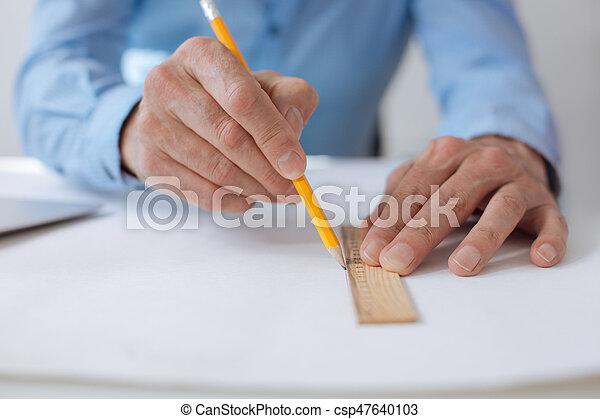 Close up of man drawign blueprint - csp47640103
