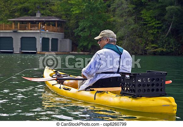 Close up of Man Fishing in a Kayak - csp6260799