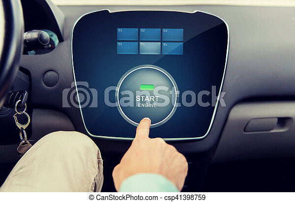 close up of man using starter application in car - csp41398759