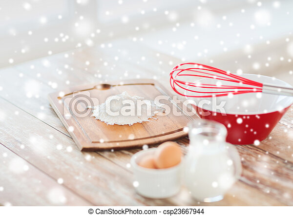 close up of milk jug, eggs, whisk and flour - csp23667944