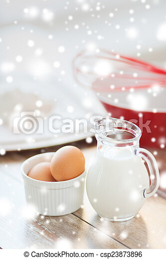 close up of milk jug, eggs, whisk and flour - csp23873896