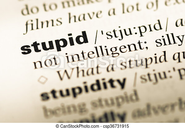 Close up of old English dictionary page with word stupid - csp36731915