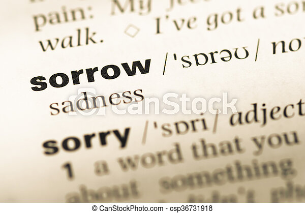 Close up of old English dictionary page with word sorrow - csp36731918