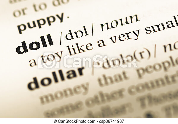 Close up of old English dictionary page with word doll - csp36741987