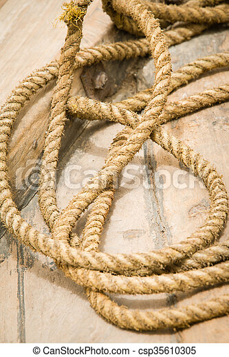 Close up of old rope on boat deck - csp35610305