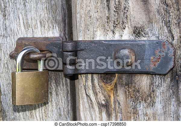 Close up of padlock and old metal hasp and staple - csp17398850