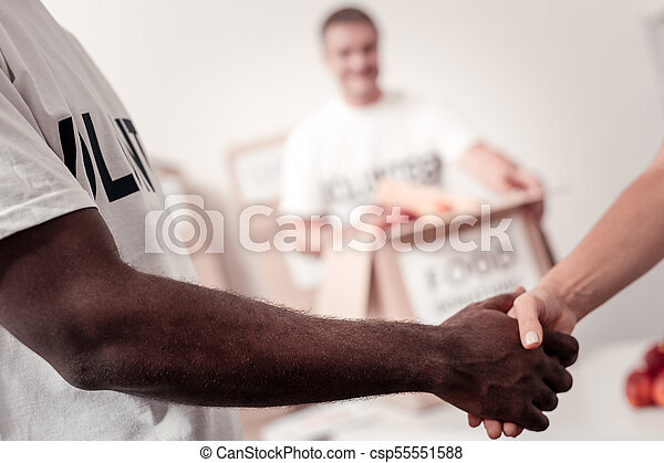 Close up of people that shaking hands - csp55551588