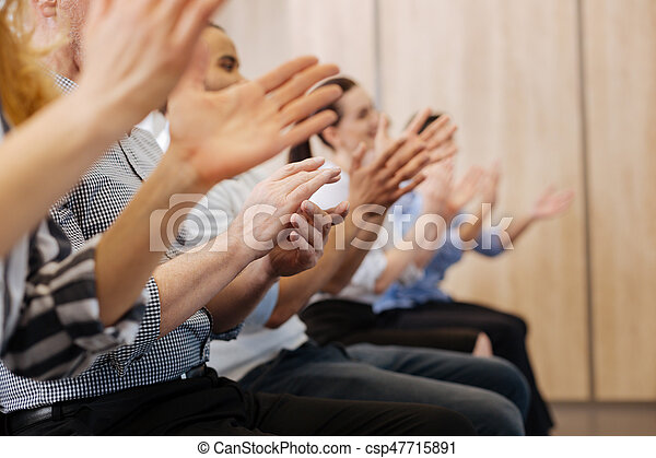 Close up of peoples hands applauding - csp47715891