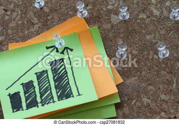 close up of pin and hand drawn business strategy graph chart on sticky note with cork board as concept - csp27081832