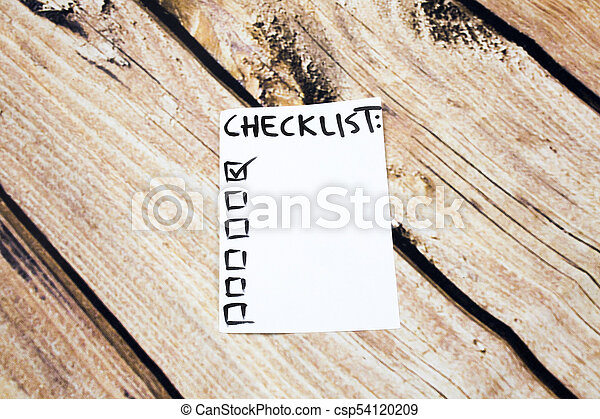close up of pin and to do list checklist word on sticky note with