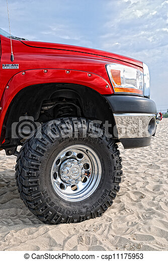 Close-up of red jeep in the dunes - csp11175953