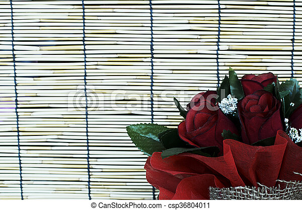 Close up of Red rose flowers in bamboo curtain backgrounds - csp36804011