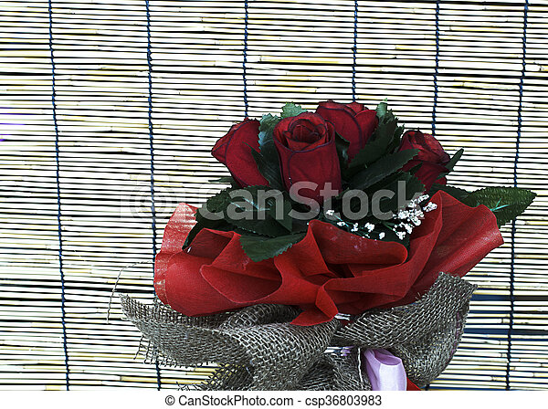 Close up of Red rose flowers in bamboo backgrounds - csp36803983