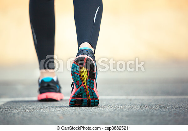 Close up of running shoes on road. - csp38825211