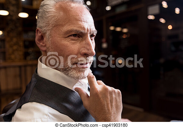 Close-up of senior man with fingers on chin - csp41903180